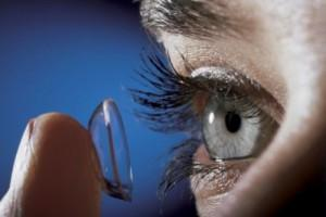 Close-up of woman putting on contact lens