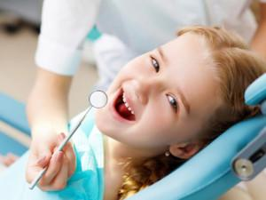 Little girl sitting in the dentists office; Shutterstock ID 153165995; PO: giugno
